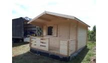 Drewniany domek z tarasem Dree